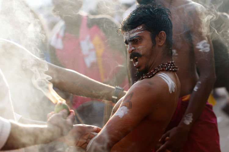 Hindu devotee in a state of trance during Thaipusam at Penang, Malaysia. ASIA Asian  Celebration Hinduism Indian Spirituality Thaipusam Close-up Culture Day Devotee Ethinic Festival Festival Hindusim Outdoors Penang Malaysia Real People Religion Religious  Traditional Young Adult An Eye For Travel Focus On The Story The Photojournalist - 2018 EyeEm Awards