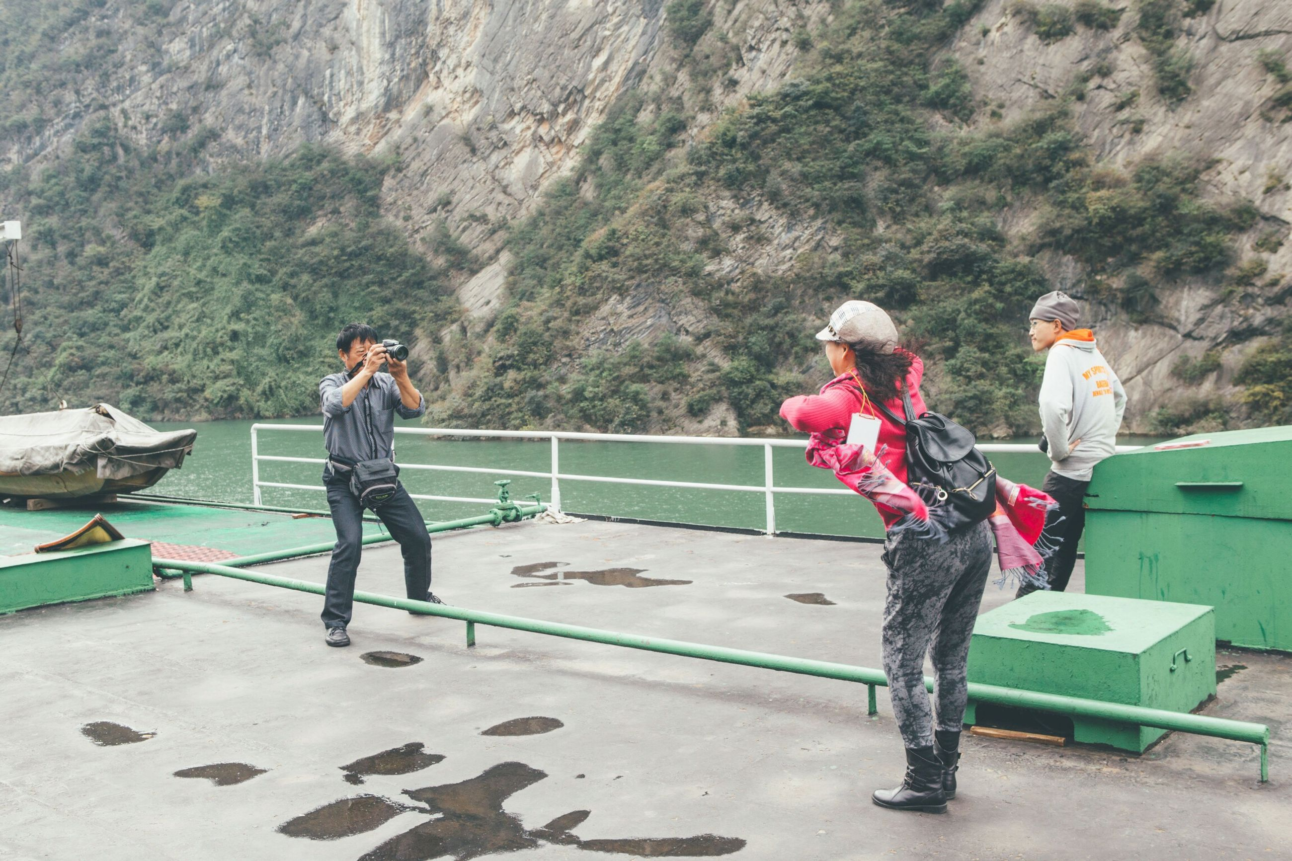 leisure activity, lifestyles, young women, full length, togetherness, young adult, person, mountain, steps, tranquility, casual clothing, water, remote, tranquil scene, nature, outdoors, scenics, rock formation, day, non-urban scene, beauty in nature, countryside