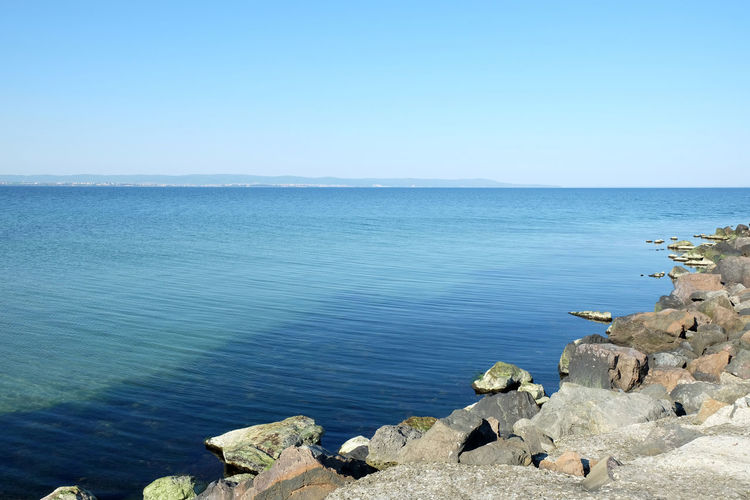 Scenic View Of Sea Against Clear Sky