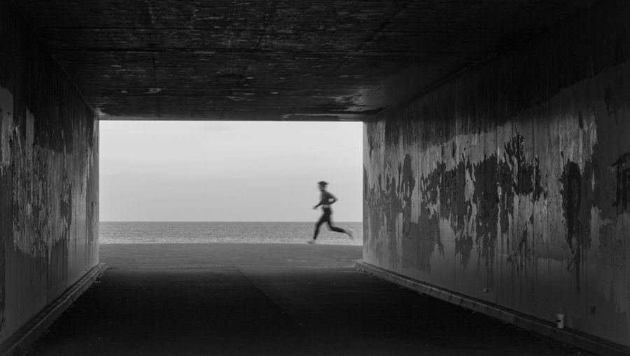 Jogging on the beach Architecture Built Structure Aberdeen Scotland Aberdeen,Scotland One Person Wall - Building Feature Silhouette Day Real People Lifestyles Horizon Over Water Horizon Sea Men Tunnel Leisure Activity Water Concrete Light At The End Of The Tunnel Running Sport Jogging Blackandwhite Black And White Black & White Brutalism Frame
