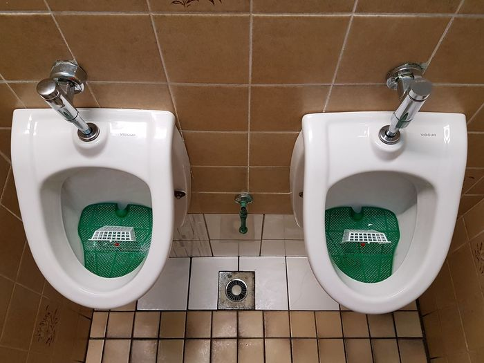High Angle View Of Urinals In Bathroom
