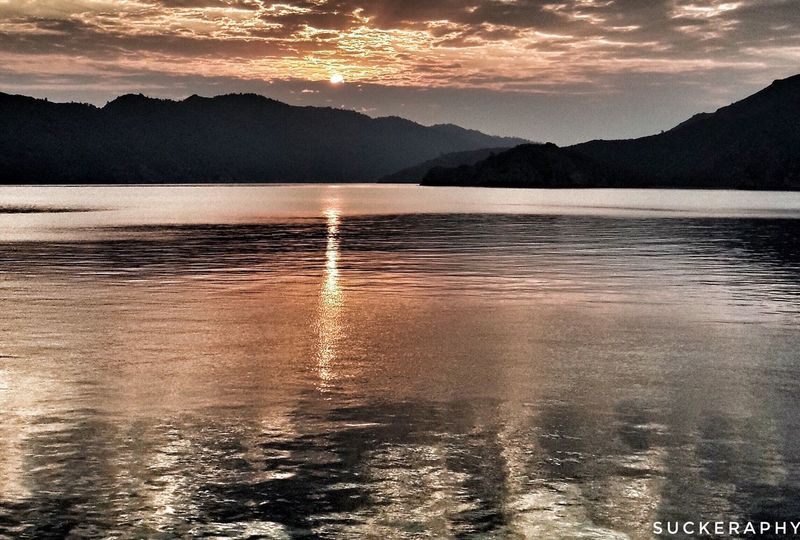 Water Mountain Scenics Tranquil Scene Sunset Beauty In Nature Mountain Range Tranquility Reflection Idyllic Lake Dusk Nature Waterfront Sky Majestic Cloud - Sky Cloud Non-urban Scene Orange Color