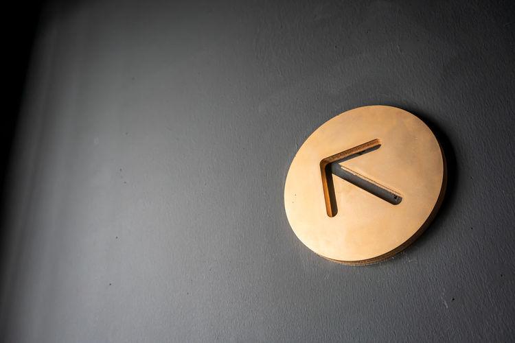 Gold arrow sign