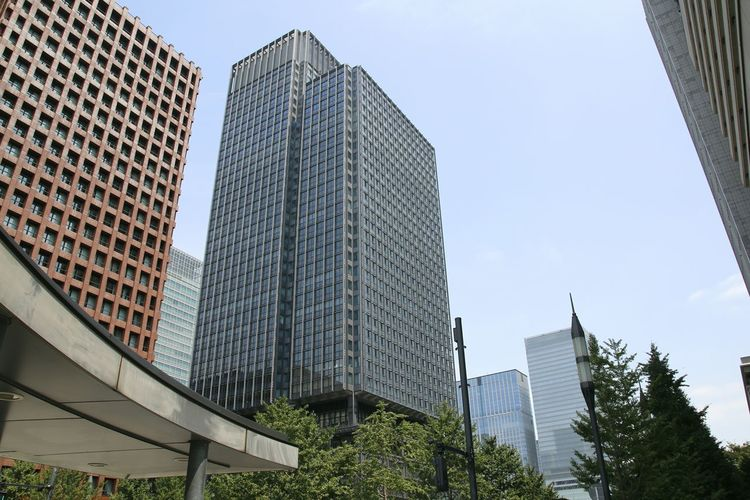 Low angle view of skyscrapers against clear sky