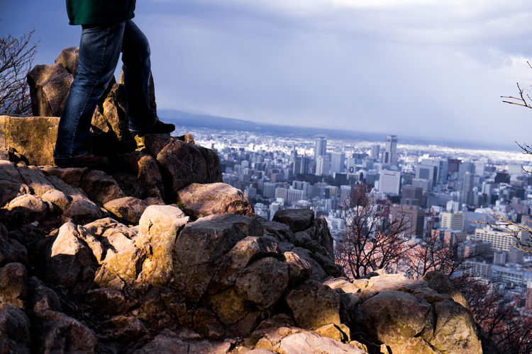 Feet on the World Cityscape Nature Rock Standing Thinking Travel Travel Photography View Winter Climbing Go Higher High Contrast Lifestyles Mountain Outdoors Rock - Object Sky Solid A New Beginning