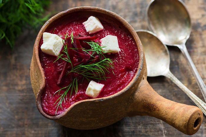 Beetroot soup garnished with feta cheese and fresh dill Beetroot Beetroot Soup Close-up Day Diet Dil Feta Feta Cheese Food Food And Drink Freshness Healthy Eating High Angle View Indoors  No People Ready-to-eat Red Soup Table Wooden Background