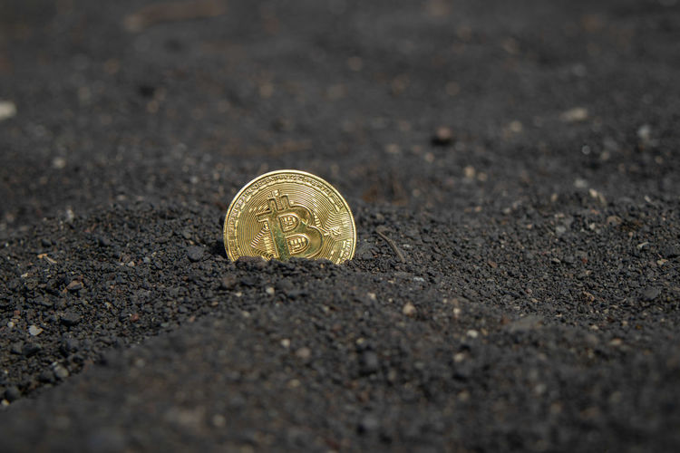 Close-up of coins on road
