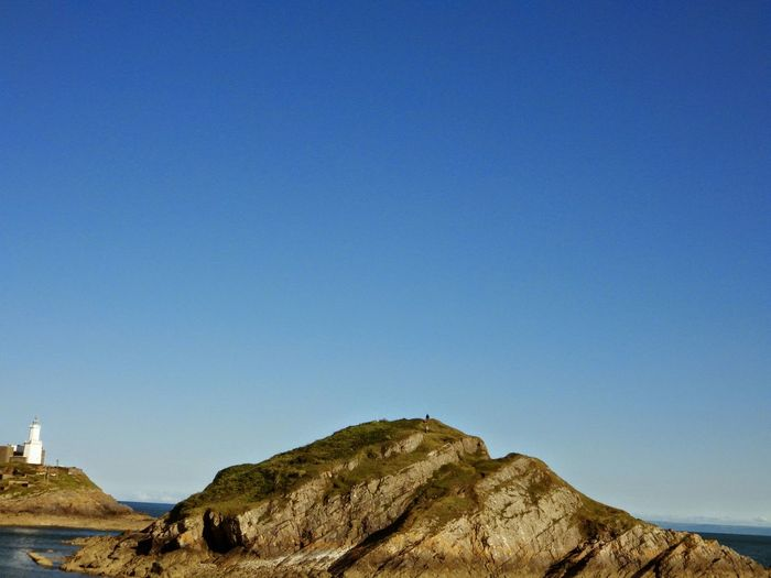 Wales Photography Taking Photos Check This Out Lighthouse Island Rocks Sea And Sky Blue Sky Seascape