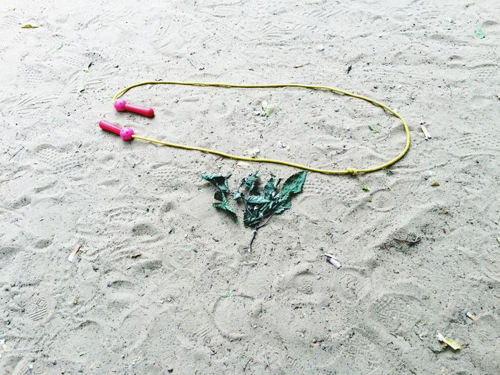 High Angle View Of Jump Rope On Sand