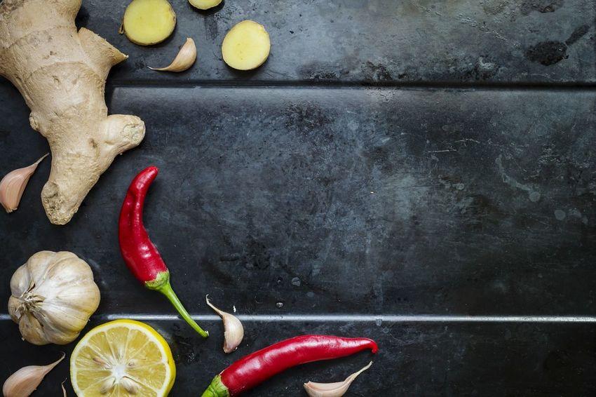 Flatlay Healthy Eating Superfood Dark Background Vitamins Cold Season Flu Ginger Garlic Pepper Lemon