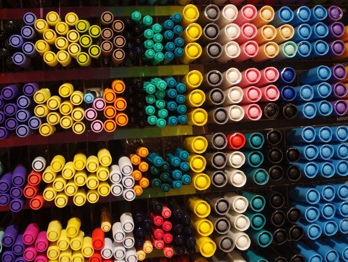 Full frame shot of colorful pens on shelves for sale