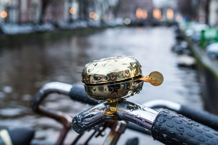 Close-up of wet bicycle on street during rainy season