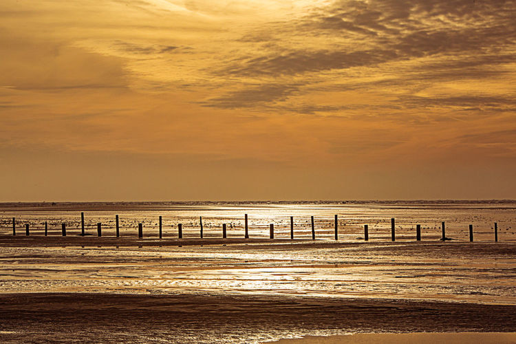 Sky Water Sea Scenics - Nature Sunset Cloud - Sky Nature Tranquility Horizon Horizon Over Water No People Beach Outdoors Environment Sunlight Motion Beauty In Nature Sankt Peter-Ording