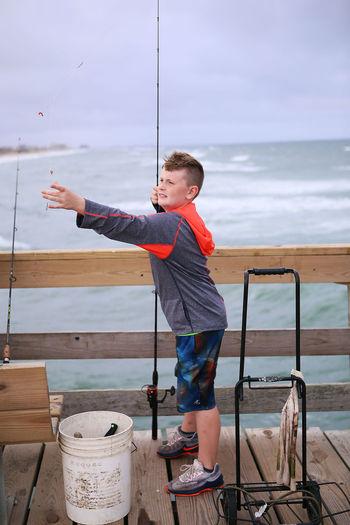 Pier Beauty In Nature Bpy Fishing Freckle Not Smiling Ocean Sand Walking On Beach Wind