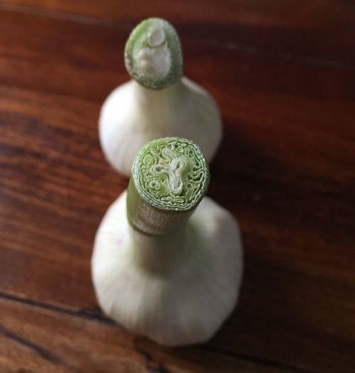 High Angle View Of Garlic Bulbs On Table