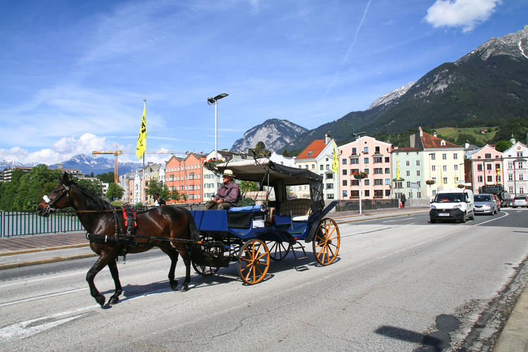 Traditional horse carriage ride in Innsbruck Austria Innsbruck Travel Animal Carriage Europe Horse Mountain Ride Sights Tour Tourism Traditional Transportation