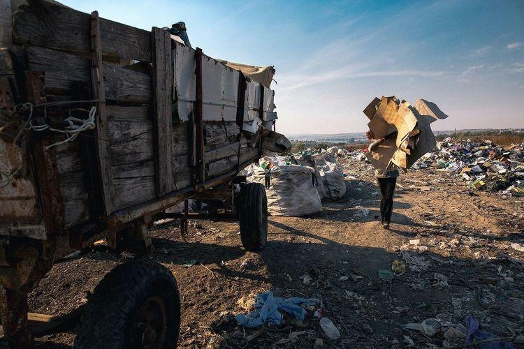 Person with garbage at junkyard