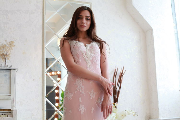 Pink Color Pink Dress Water Wedding Dress Bride White Background One Person Standing Young Adult Young Women Real People Women Lifestyles Beauty Beautiful Woman Three Quarter Length Leisure Activity Portrait Clothing Fashion Dress Architecture Hairstyle Contemplation Outdoors