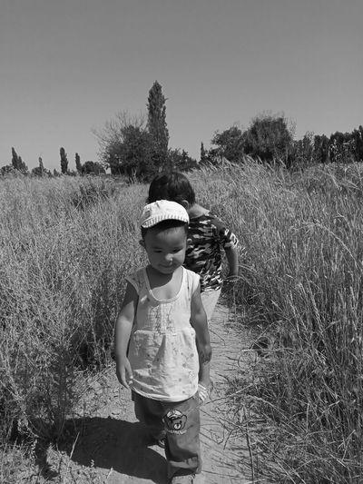 Full length of cute boy standing on field