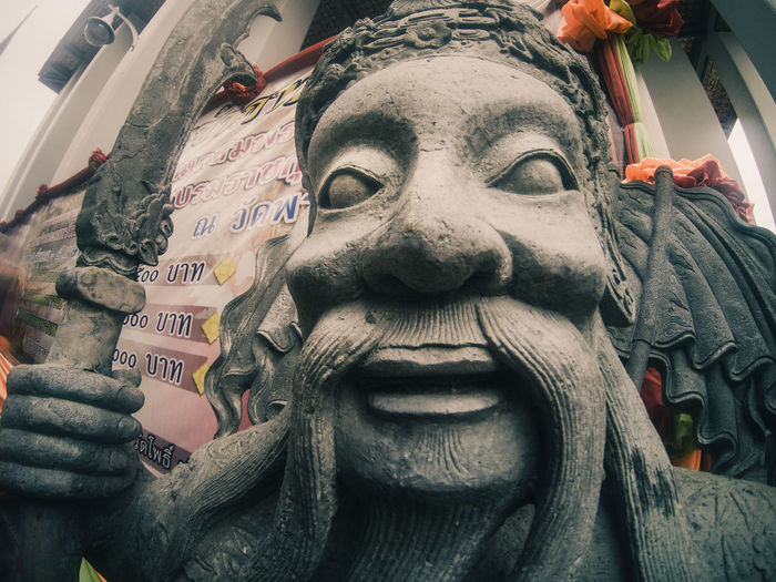 Closeup of a chinese statue at the Wat Pho temple in Bangkok, Thailand Bangkok Statue Thai Thailand Wat Pho Architecture Art And Craft Close-up Craft Creativity Golden Buddha Human Representation Landmark Low Angle View Male Likeness No People Representation Sculpture Statue Travel Destinations
