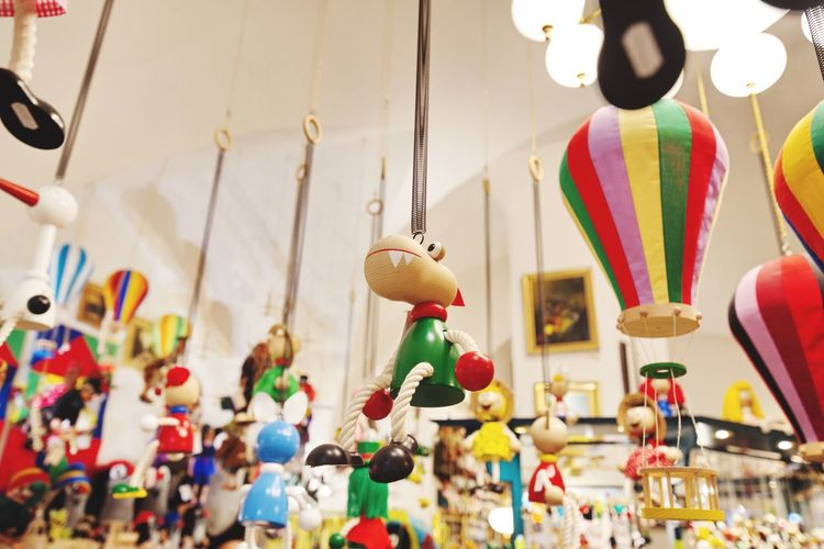 Low angle view of toys hanging from ceiling in store