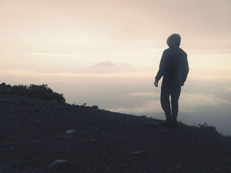 sunrise from the top of the volcano Indonesia_photography Yogjakarta Sunrise Volcano Full Length Men Mountain Standing Sunset Silhouette Adventure Lake Sky Landscape Hiker Hiking Hiking Pole Mountain Peak The Traveler - 2018 EyeEm Awards The Great Outdoors - 2018 EyeEm Awards