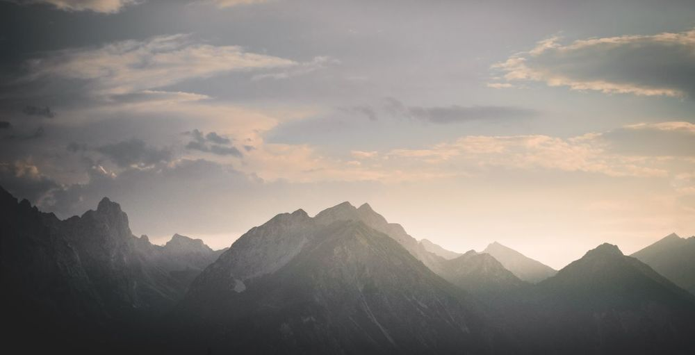 Mountain Beauty In Nature Sky Cloud - Sky Mountain Range Scenics - Nature Tranquility Tranquil Scene Mountain Peak Majestic Idyllic Outdoors Remote Non-urban Scene No People Environment Sunset Nature Landscape