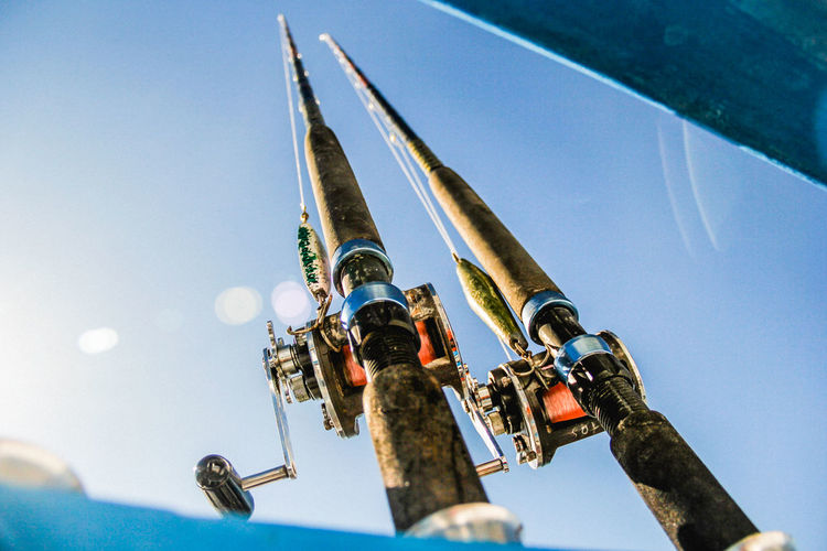 Low Angle View Of Fishing Poles Against Sky