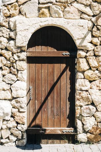 Closed door of stone wall