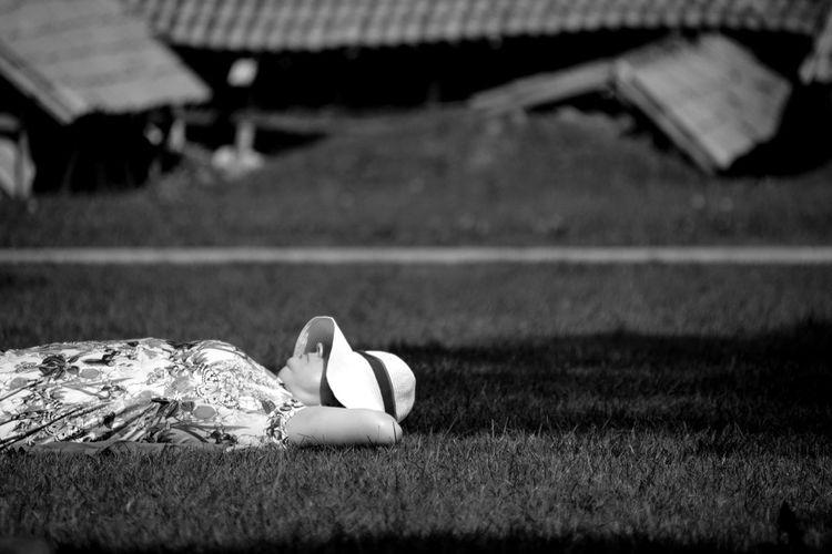Couple lying on field