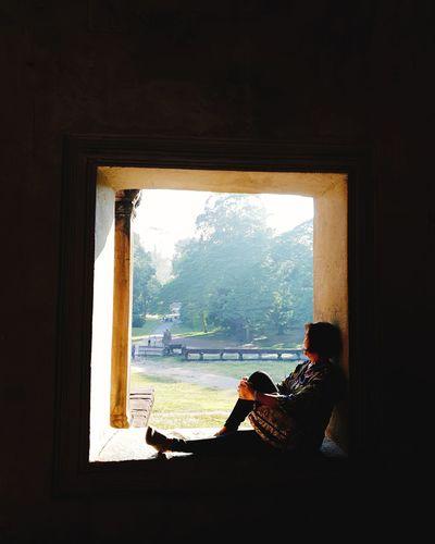 women sitting in window My Mom EyeEm Selects Feminine  Old-fashioned Tree Full Length Window Domestic Life Architecture Silhouette Hiker Window Frame Evening Sunrise Orange Color Sunset Bare Tree