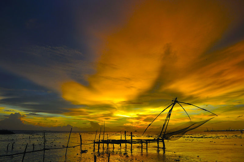 A traditional Chinese fishing net Atmosphere Atmospheric Mood Chinese Fishing Net Cloud Cloudscape Cloudy Dramatic Sky Fishing Net Light Moody Sky Outdoors Sky Sunset Traditions Travel Travel Photography Weather