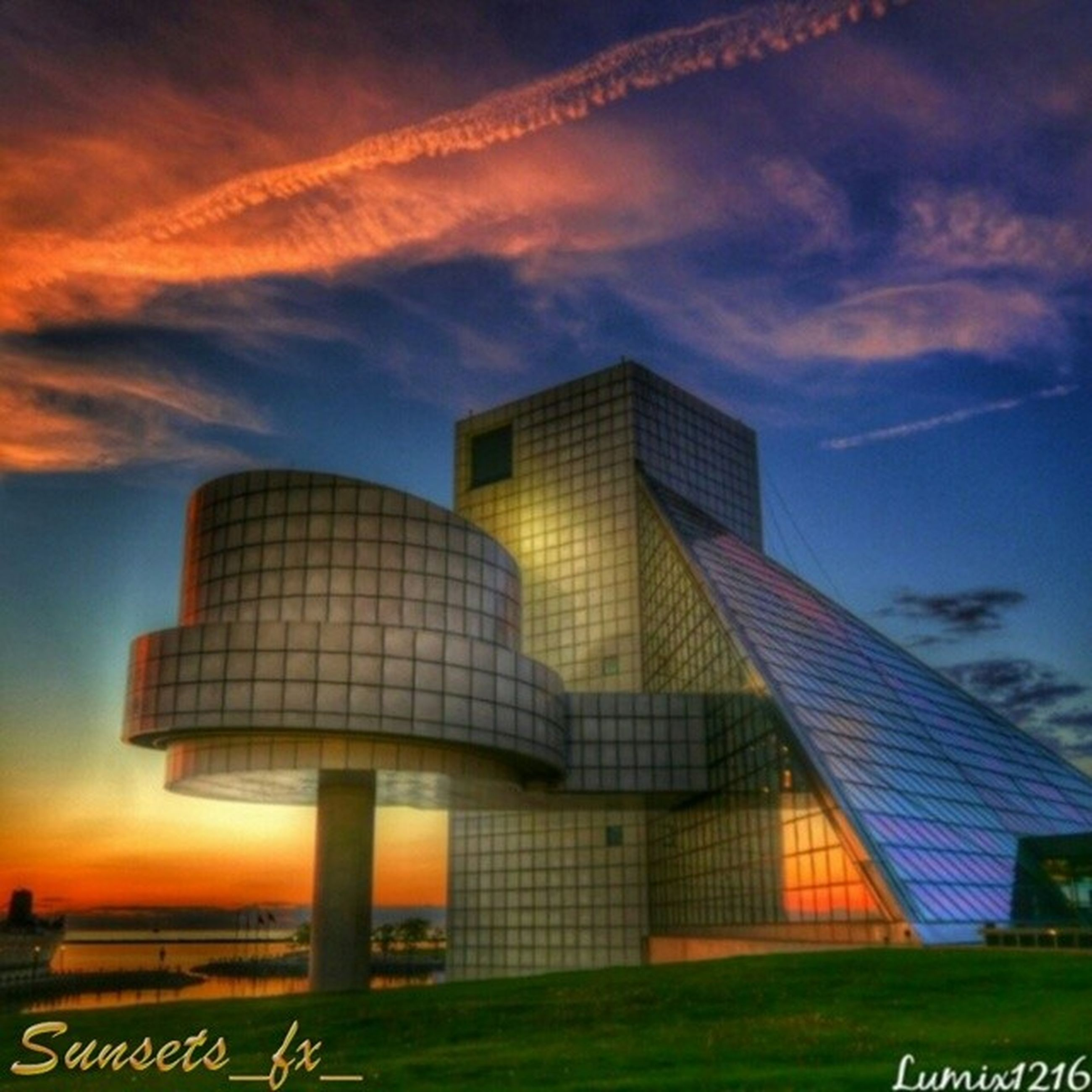 architecture, built structure, building exterior, sunset, sky, cloud - sky, modern, city, cloud, office building, tower, orange color, skyscraper, cloudy, tall - high, low angle view, building, outdoors, no people, factory