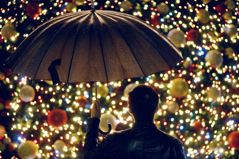 Merry after christmas Christmastime Christmas Lights Christmas Decoration Rear View Umbrella Illuminated Real People Protection Tree One Person Decoration Multi Colored Nature Outdoors Lifestyles Focus On Foreground Adult Leisure Activity Men Lighting Equipment Plant 2018 In One Photograph Moments Of Happiness EyeEmNewHere Moments Of Happiness