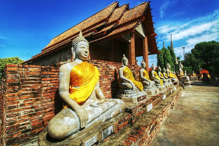 Row Of Buddha Statues At Wat Yai Chai Mongkhon