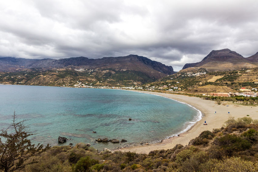 Plakias bay, south Crete, Greece Crete Greece Greece, Crete Growth Holiday Holidays Bay Beach Beauty In Nature Clear Water Clouds And Sky Crete Greece Landscape Mountain Mountain Range Plakias Sand Sand Dune Scenics Sea Tourism Tranquil Scene Tranquility Travel Destinations Turquoise