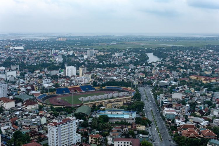 Sport complex of Hue city. Huế Stadium Vietnam Aerial View Architecture Building Building Exterior Built Structure City City Life Cityscape Crowd Crowded High Angle View Outdoors Residential District Sport Sport Complex Stadium Architecture Town Transportation Urban Sprawl