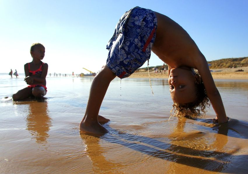 Algarve Beach Life Beach Photography Blue Sky Boy Children Photography Dripping Summer Upside Down Children Day Sand Shore Carefree Boy And Girl
