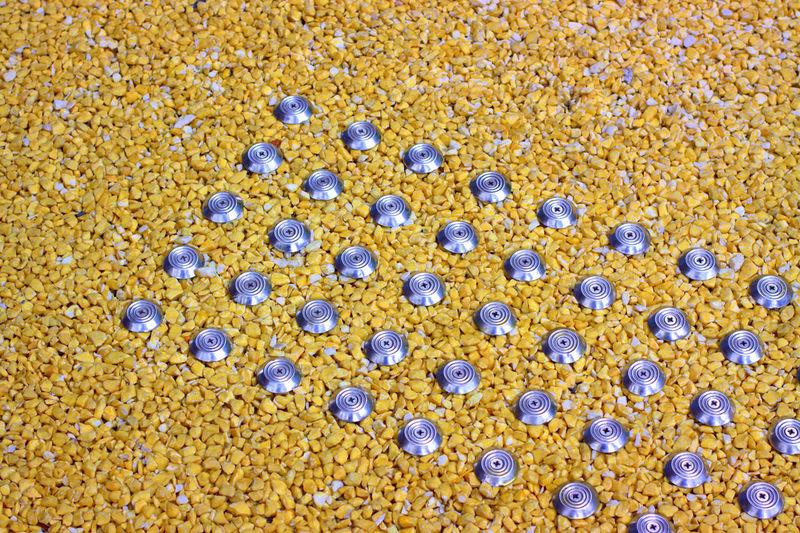 Full frame shot of yellow flowers on sand