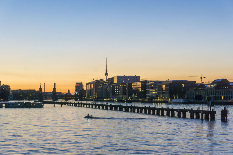 Spree River with Molecule Men and TV Tower Berlin Germany 🇩🇪 Deutschland Molecule Men Spree River Berlin TV Tower Architecture Building Exterior Built Structure City Cityscape Clear Sky Color Image Day Modern Nature No People Outdoors River Sky Skyscraper Sunset Travel Destinations Urban Skyline Water Waterfront
