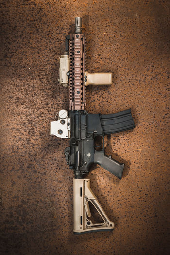 assault rifle on the industrial background Gun Soldier Assault Assault Rifles Bullet Close-up Combat Handgun Indoors  Military No People Rifle Steel Table Weapon