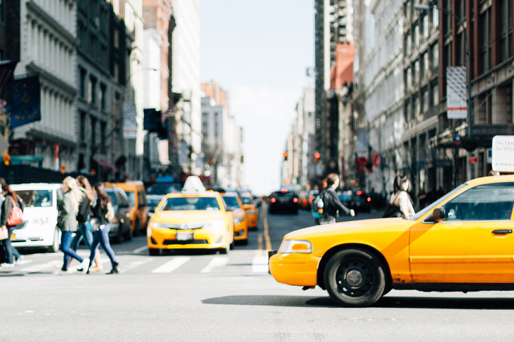Car Mode Of Transportation City Manhattan New York Taxi Intersection Motor Vehicle Transportation Architecture Street Yellow Building Exterior Yellow Taxi Built Structure Land Vehicle City Life City Street Traffic Road Day Outdoors