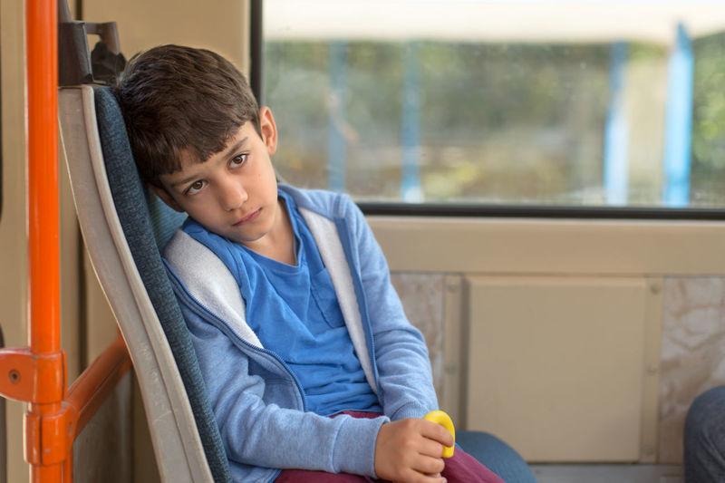 Boy Sitting On Bus