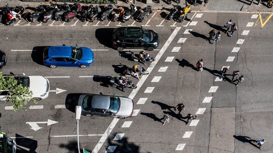 High Angle View Of People And Vehicles On City Street