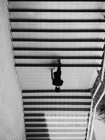 Upside down Sunlight One Person Outdoors Day Shadow Steps Steps And Staircases Built Structure Men Staircase People Adult One Man Only Only Men Adults Only Human Body Part The City Light