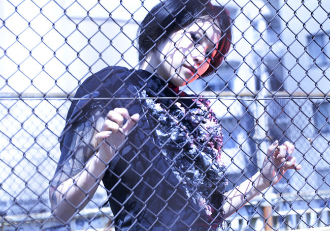Female Model in Tokyo, Japan behind a fence. Cool Japan Tokyo Beauty Chainlink Fence Close-up Day Female Focus On Foreground Model One Person Outdoors People Real People Young Adult