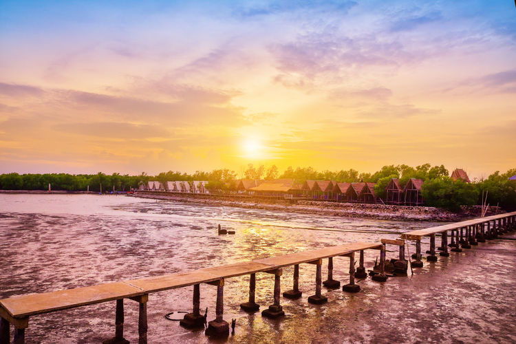 Beach at Samut Sakhon Thailand,Beautiful sunset nature background Architecture Beauty In Nature Built Structure Cloud - Sky Idyllic Nature No People Orange Color Outdoors Railing River Scenics - Nature Sky Sunset Swimming Pool Tranquil Scene Tranquility Tree Water The Still Life Photographer - 2018 EyeEm Awards The Great Outdoors - 2018 EyeEm Awards