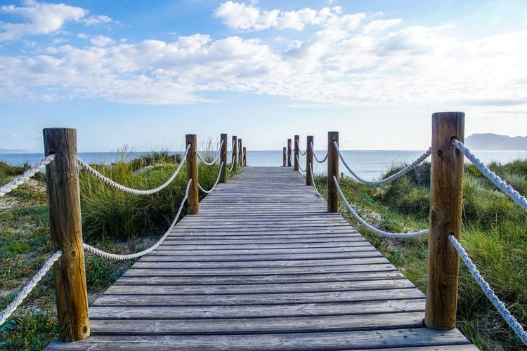 Krull&Krull Images Mallorca Beauty In Nature Cloud - Sky Day Grass Horizon Over Water Mallorca Nature No People Outdoors Railing Scenics Sea Sky Son Serra De Marina Steg The Way Forward Tranquil Scene Tranquility Water Wood - Material Wood Paneling Wooden Post