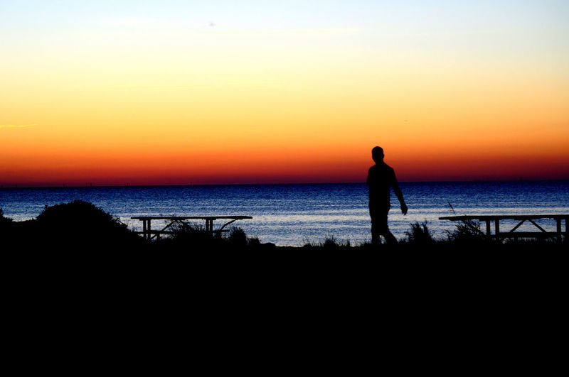 Amazing View Beauty In Nature Check This Out Horizon Over Water Nature OBX Ocracoke Island One Person Outdoors Outer Banks, NC Silhouette Silhouette Silver Lake Sunset Tranquil Scene Tranquility Water