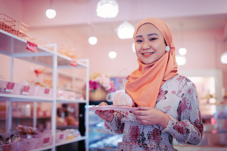 Young woman using smart phone at store